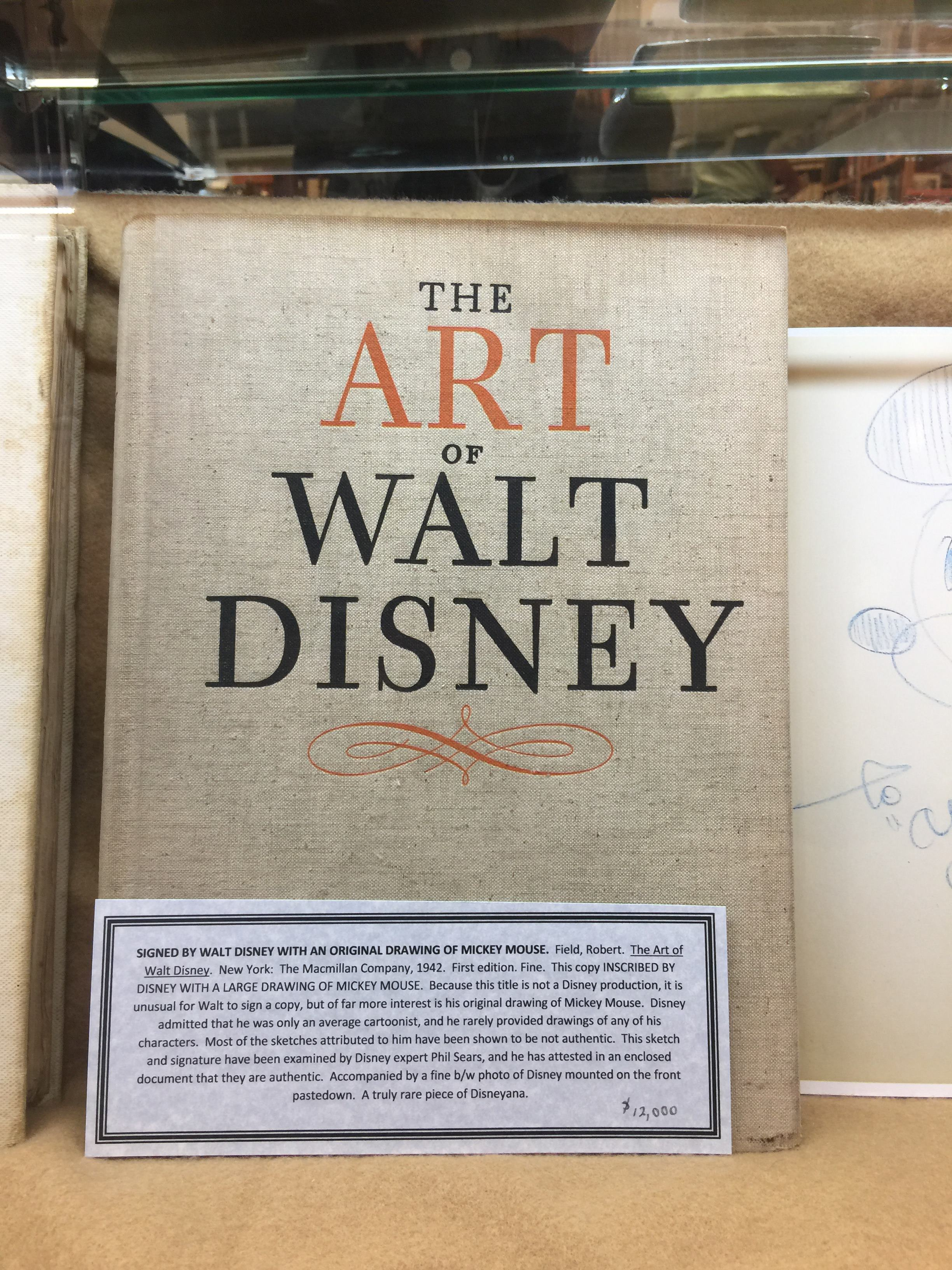 The art of Walt Disney with a hand-drawn sketch of Mickey Mouse by Disney himself inside